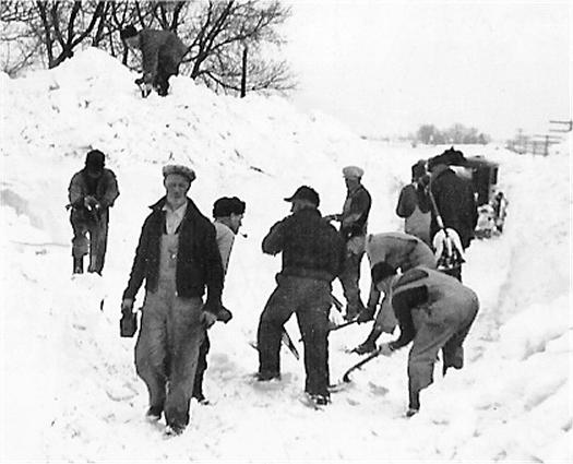 Rutland men shoveling snow